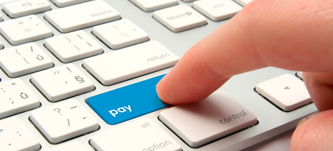 hand pressing blue pay keyboard key - online bill pay