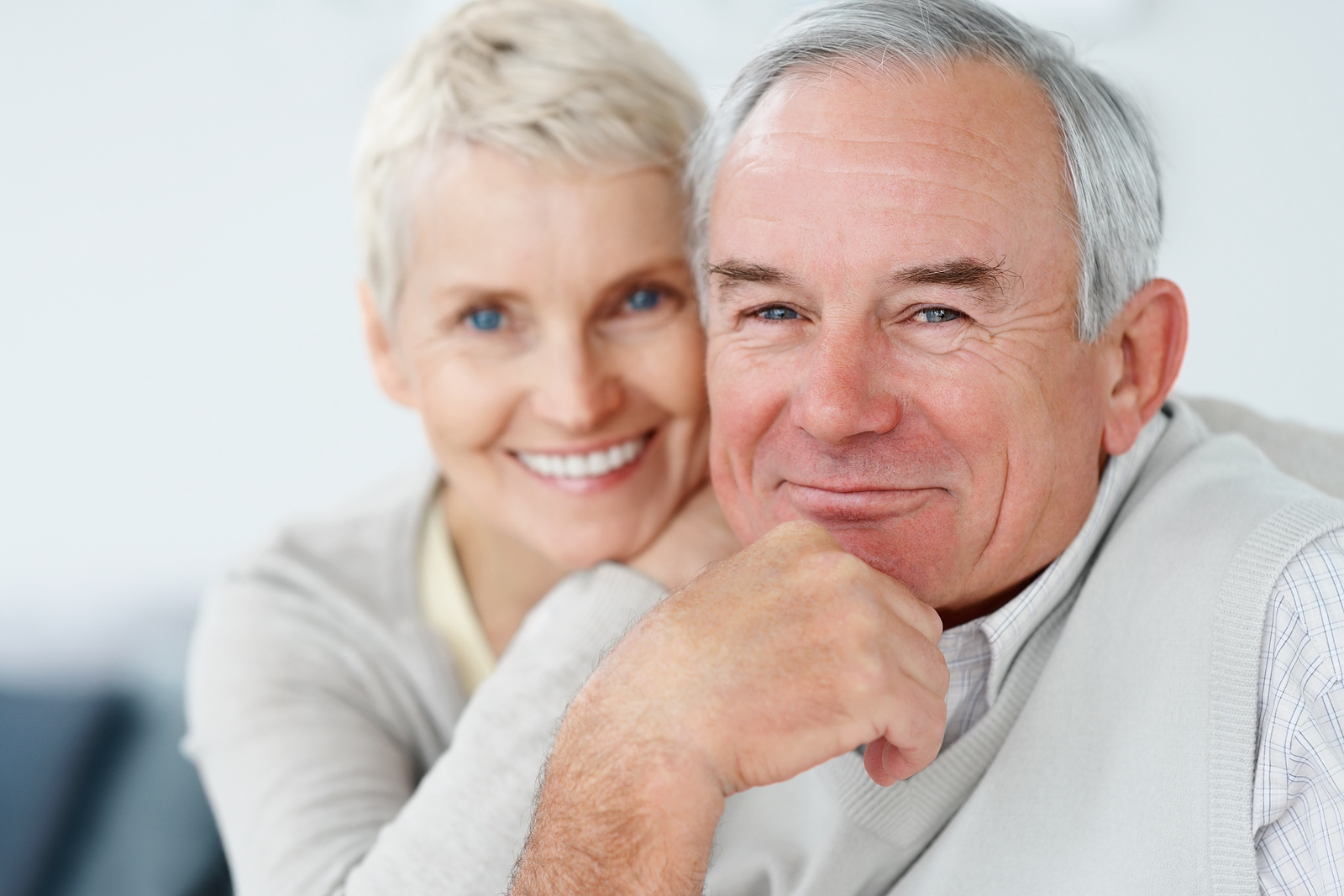 Older couple sitting together and smiling